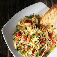 Scampi with pan seared shrimp, cilantro-lime butter, chilies, tomatoes, garlic and Parmesan over spaghetti and zucchini noodles with grilled Swamp Rabbit Stecca bread