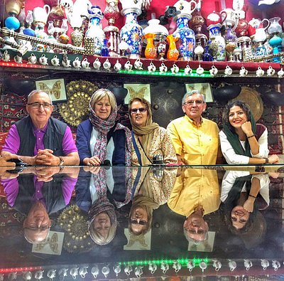 an energetic small group tour in Iran in a cafe in Isfahan with their UpPersia tour leader Leila