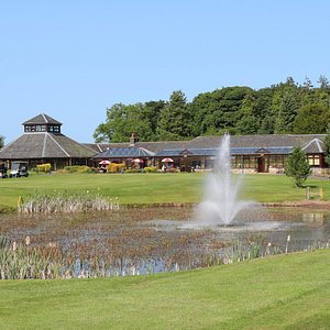 Our clubhouse looks out onto our beautiful 18 holes, with lovely outdoor seating to relax in the sun.