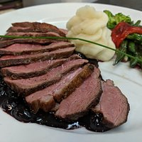 Duck breast in blueberry sauce.