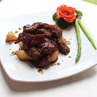 Beef cubes with squid sauce