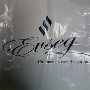 The Wrapper of the Cashmere & Camel Wool Shop, Evseg