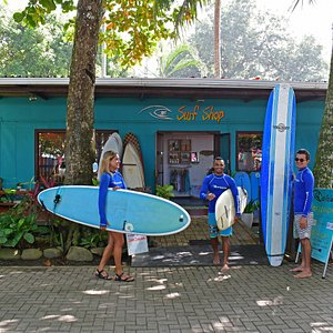 Costa Rica Surf Camp instructors in front of store