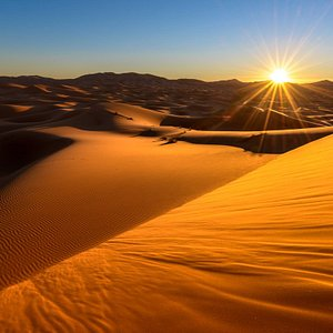 Sunset over the dunes of the Sahara Desert - see this wonderful sight on one of our Sahara Desert tours.
