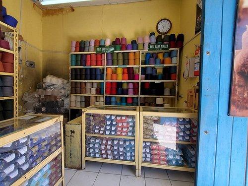 Blue door is the front door of the shop.