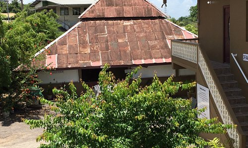 House used by early indentured laborers who settled in Trinidad to work the sugar cane or cocoa plantations. The roof is tin sheets and walls and floors made of gobar - mixture of dirt and cow dung.