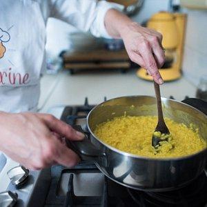 Preparing Saffron risotto in Milan.