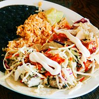 Quesadillas. A special Mexican dish that comes with boiled black beans, spicy rice, and chicken tossed with mayonnaise, & chopped vegetables. Sprinkle it with lemon juice to taste
