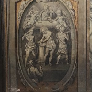 Ornate panel of pre-nailing Jesus to the Cross.