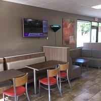 Looking at cash register and menu display.
