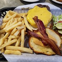 Hamburger with bacon and fries