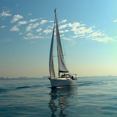 Yacht Sam on calm waters