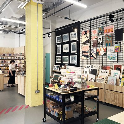 Cards and prints on display, with large print racks to flick through. Our artist showcase space rotates with a new artist every few weeks.