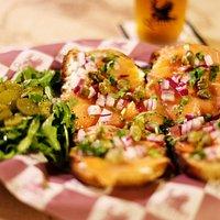 Salmon Bruschetta. Artisanal bread, smoked salmon.