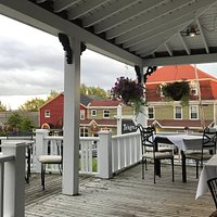 Outdoor dining setting at the The Cable Room At the Telegraph House, Baddeck, NS