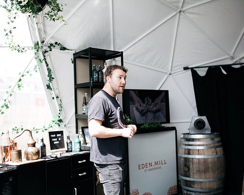 """Whilst our new distillery & brewery is under construction, we welcome you to """"The Gatehouse"""". Join us for an hour-long session where we'll sample gins from our range, advise you on how best to serve them, and tell you all about the creativity and innovation that has made Eden Mill one of Scotland's most popular gin distilleries. You'll leave with a branded Eden Mill glass, and can pop by our shop next door."""