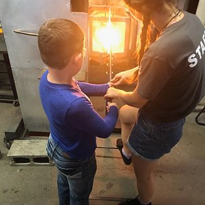 heating up the glass so it can be molded