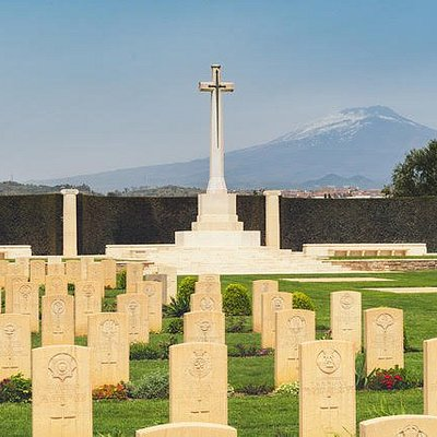 Catania War Cemetery with Mount Etna in the background.