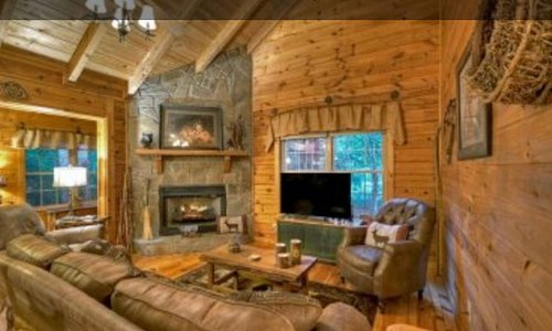 Living Room and Fireplace with TV at the log cabin. Bach's Creekside Retreat