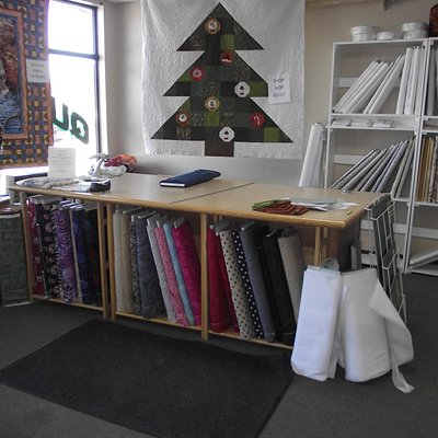 NH - KINGSTON - STITCHED IN STONE - SEWING SIDE - CUTTING TABLE & SOME FABRICS