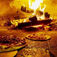 Our pizzas are cooked in a wood fired oven