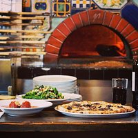 Best wood fired pizza in Scottsdale. Enjoy our always fresh, made daily bread, olives, appetizers, salads and topped off with a unique and savory selection of pizzas.  This will be an experience to remember.