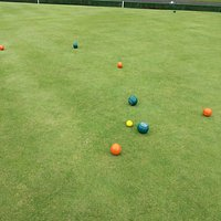 """The """"jack"""" is the small yellow target ball.  One player had green balls and one had orange."""