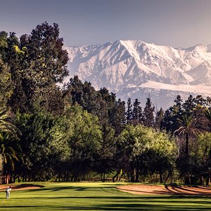 Royal Golf Marrakech and the Atlas Mountains in the background.