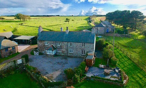 Ariel Photo of Farm house and Cottage behind. Parking and Patio