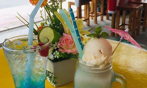 vanilla shake with vanilla ice cream and blue lemon Italian soda