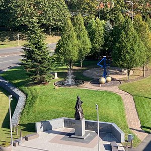 A picture of the Lions of the Great War monument and green space.
