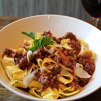 Our pappardelle bolognese has red wine-braised beef & pork, red sauce, parmesan and pecorino cream. It's delicious comfort food.