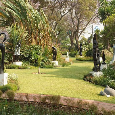 The glorious view of the gardens stretching away from the koi pond; the sculpture garden is full of fascinating sculptures from Zimbabwe's best artists