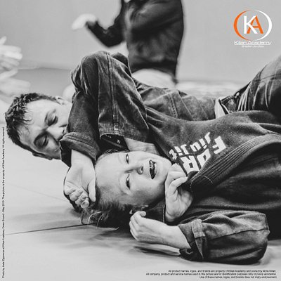 Kilian Academy student, Christeen Christeena Nienhuis smiling whilst being choked by Sensai Abrie Kilian. Photo by Jade Elgersma.