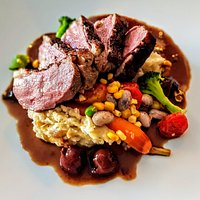 Roasted Breast of Duck: Caramelized Onion & Sour Cream Whipped Potatoes, Baby Carrots, Cherry Cinnamon Jus