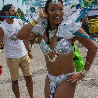 Happy masquerader at Toronto Caribbean Carnival 2019