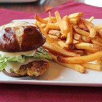 Our Popular Schnitzel sandwich served on a pretzel bun accompanied with french fries.