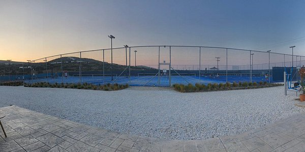 Panoramic view. Blue like the Aegean sea. A fantastic experience to play tennis on these courts!