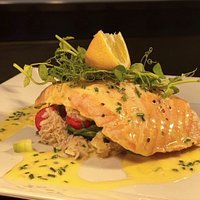 Salmon fillet served with samphire, tomato and crab salad