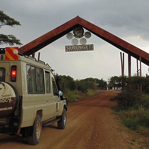 4x4 modified safari jeep at the main gate to the world famous Serengeti National Park.