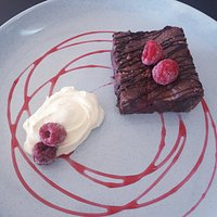 Raspberry Brownie😋.  All sweet freshly made in the cafe.