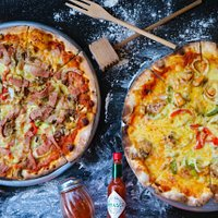 Our Meat lover pizza on the left and our Fruti del mare pizza (seafood) on the right