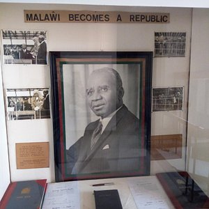 Portrait of Hastings Kamuzu Banda and photos and copies of legal instruments marking Malawi's transition to  a republic, and Banda's presidency-for-life