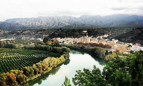 A view of Tivenys nestled on the banks of the river Ebro.
