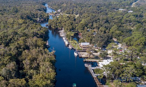This is an aerial shot of Captain Ricks boat heading out on another Eco-Tour down the Withlacoochee river.  Note the Gulf of Mexico at the top of the photo.