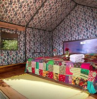 Stay in one of our comfortable glamping tents, tucked away in our vegetable and herb garden with a spectacular panoramic view of the valley. All tents have a double bed with 6inch mattress, heated mattress for your comfort, light, power socket, usb charging point, Side tables and cloth hangers.