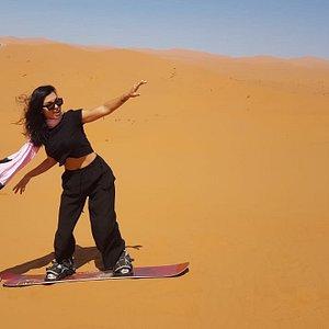 Sandboarding in the Sahara Desert