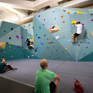 Spacious bouldering area with safety matting below.