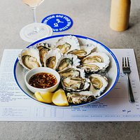 Our fresh oysters served with lemon and oak-aged chardonnay mignonette.