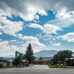 Motel entrance and surrounding mountain views